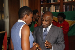 The Honourable Minister of Foreign Affairs Mr. Carl Greenidge interacting with a member of the Diaspora